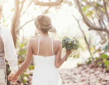 Shifts in temperature are leading to shifts in the wedding industry as bakers, photographers, florists and the couples they serve think about how to beat the heat on this all-important day. (JGI/Daniel Grill/Getty Images/Blend Images)