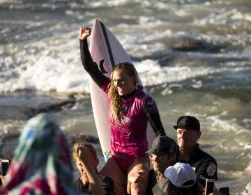 U.S. surfer Lakey Peterson is carried up the beach after claiming victory in a World Surf League event in Australia in March. The league says it will start paying the same prize money to men and women. (Jason Childs/Getty Images)