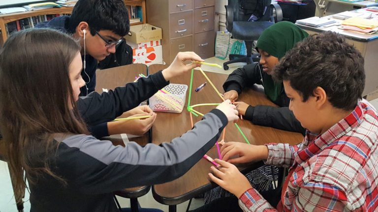 Freshmen at St. Louis Park High School, just outside of Minneapolis, take time out of their social studies class for a team-building exercise that is part of the school's Building Assets, Reducing Risks program. (Tara García Mathewson/The Hechinger Report)
