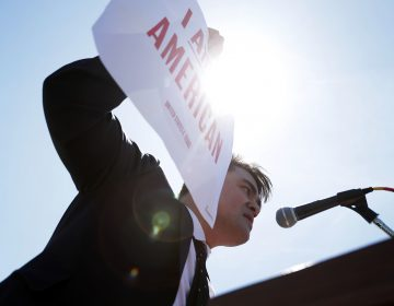 Jose Antonio Vargas, pictured at a rally in front of the U.S. Supreme Court in 2016, has written a memoir of his life as an undocumented immigrant in Dear America. (Alex Wong/Getty Images)