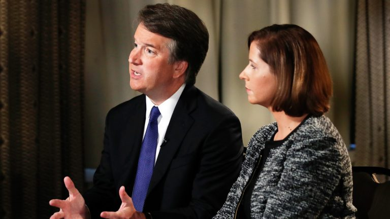 Brett Kavanaugh, with his wife Ashley Estes Kavanaugh, answers questions during a FOX News interview, Monday, Sept. 24, 2018, in Washington, about allegations of sexual misconduct against the Supreme Court nominee. (Jacquelyn Martin/AP Photo)