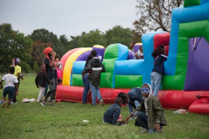 Kids play on a bouncy castle at Strawberry Mansion Day. (Emily Cohen for WHYY)