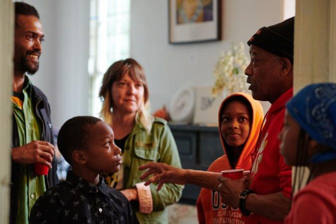 Kier Johnston (left) talks with neighborhood children and residents at Hatfield House. (Albert Yee for Fairmount Park Conservancy)