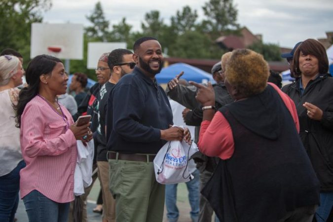 Councilman Curtis Jones (center) came out for Strawberry Mansion Day. (Emily Cohen for WHYY)