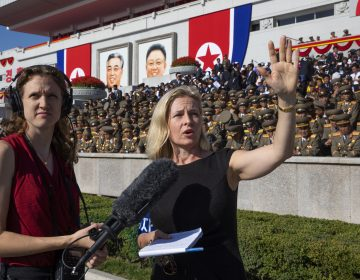 All Things Considered host Mary Louise Kelly (right) records a standup with producer Becky Sullivan at Kim Il Sung Square in Pyongyang ahead of a military parade marking the 70th anniversary of North Korea's founding. (David Guttenfelder/for NPR)