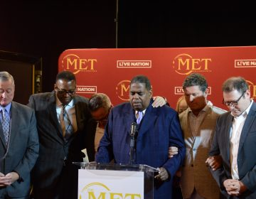 City officials and developers pray at Monday's announcement on the historic Met's reopening in Decemebr. (Tom MacDonald/WHYY)