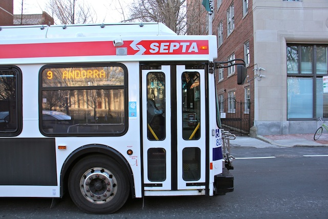 A SEPTA bus travels west on Walnut Street. Route 9 is the worst SEPTA bus route for time performance. (Emma Lee/WHYY)