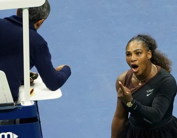 In this Saturday, Sept. 8, 2018, file photo, Serena Williams argues with the chair umpire during a match against Naomi Osaka, of Japan, during the women's finals of the U.S. Open tennis tournament at the USTA Billie Jean King National Tennis Center, in New York. Some black women say Serena Williams' experience at the U.S. Open final resonates with them. They say they are often forced to watch their tone and words in the workplace in ways that men and other women are not. Otherwise, they say, they risk being branded an