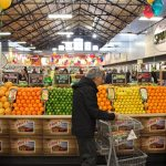 A shopper browses the produce at the new Sprouts market on South Broad Street. (Emma Lee/WHYY)