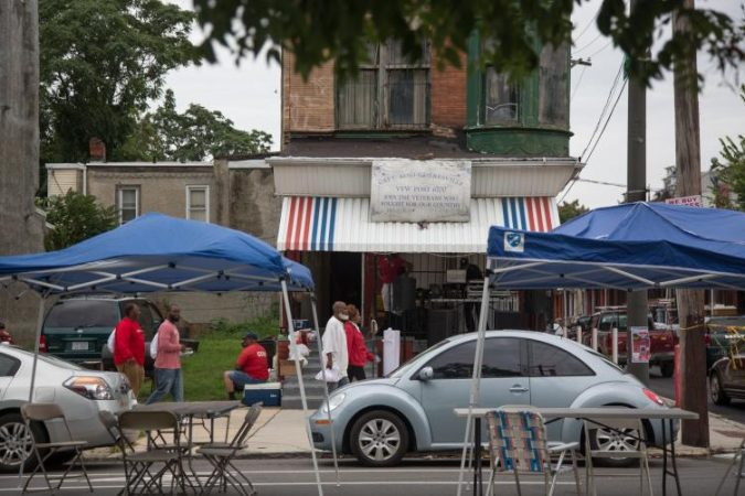 A neighboring street throws their own block party across from the 12th Annual Strawberry Mansion Day in North Philadelphia on Sept. 9, 2018. (Emily Cohen for WHYY)