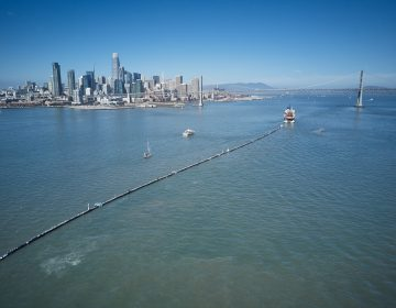 A nearly 2,000-foot-long tube is towed offshore from San Francisco Bay on Saturday. It's a giant garbage collector, and the brainchild of 24-year-old Boyan Slat, who aims to remove 90 percent of ocean plastic by 2040. (The Ocean Cleanup)