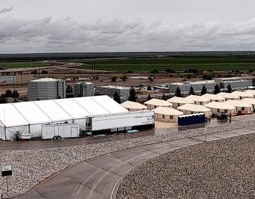 This undated file photo provided by HHS' Administration for Children and Families shows the shelter used to house unaccompanied foreign children in Tornillo, Texas. The U.S. government says the West Texas tent shelter will remain open through the end of the year. A spokesman for the U.S. Department of Health and Human Services said Tuesday, Sept. 11, 2018, that the facility will be expanded to 3,800 beds from its initial capacity of 360 beds. (HHS' Administration for Children and Families via AP, File)