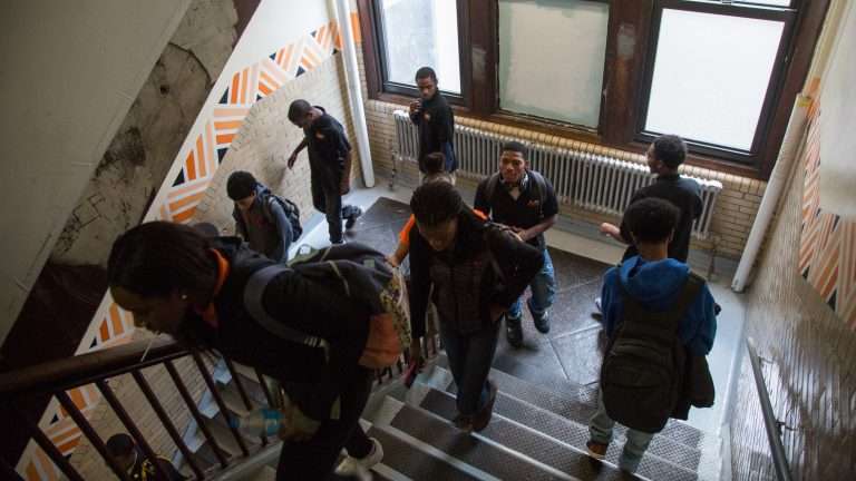 Students pass though a stairwell at Overbrook High School. (Emily Cohen for WHYY)