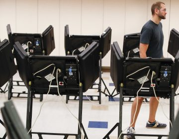 Voters cast their ballots in August among an array of electronic voting machines in a polling station at the Noor Islamic Cultural Center in Dublin, Ohio. The machines were manufactured by Elections Systems and Software, the largest manufacturer of voting equipment in the country. (John Minchillo/AP)
