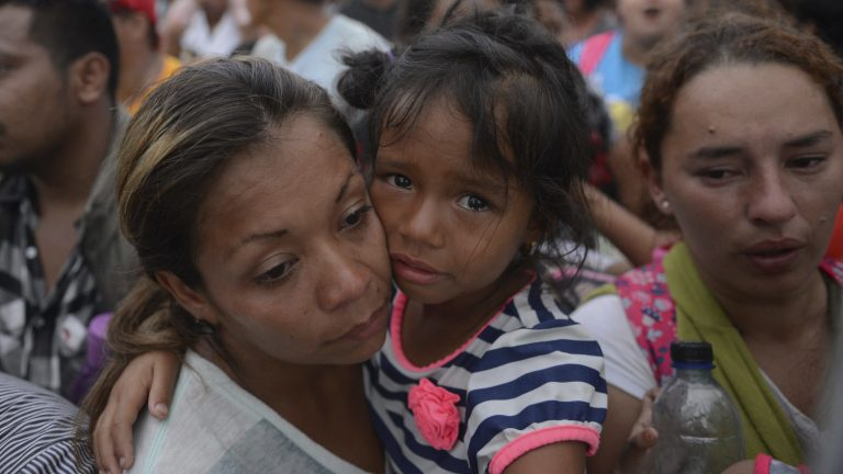 Thousands of migrants attempted to cross the border from Guatemala into Mexico this week. Many of the migrants have reportedly returned to their home countries of Honduras and Guatemala. (Oliver de Ros/AP)