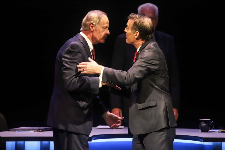 Incumbent Democrat U.S. Sen. Tom Carper (left) shakes hands with Republican challenger Rob Artlett prior to their debate that later grew contentious. Wednesday night. (Saquan Simpson for WHYY)