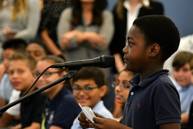 A student asks a question at a gubernatorial forum at the School District of Philadelphia's headquarters. (Bastiaan Slabbers for Keystone Crossroads)