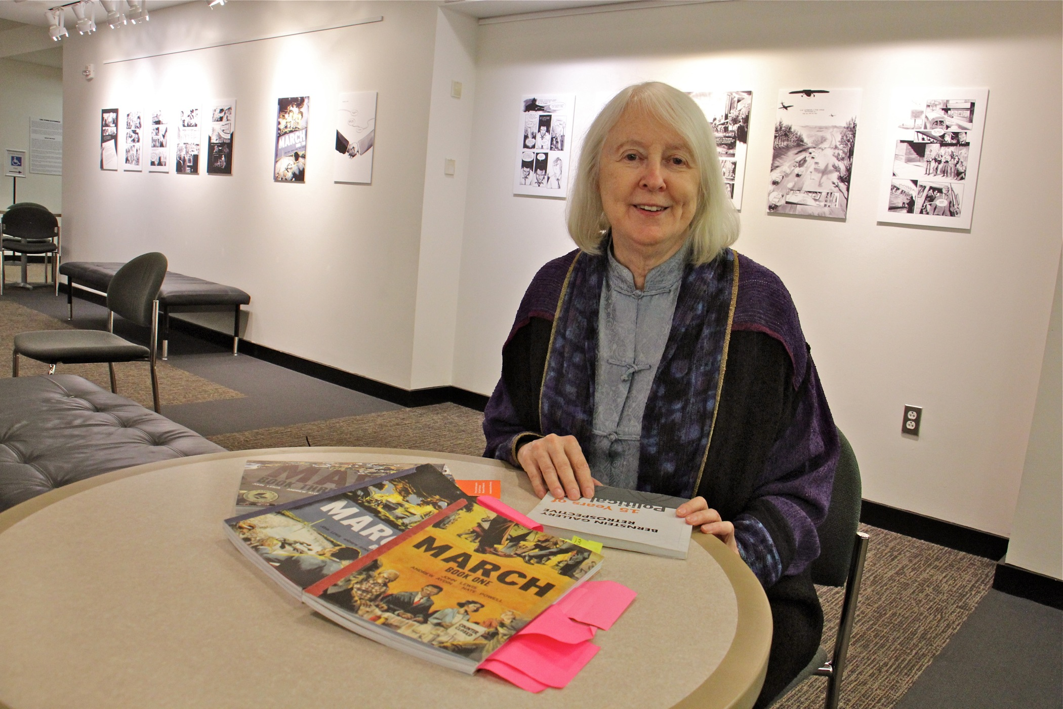 Mary Oestereicher Hamill, co-director of the Bernstein Gallery at Princeton University, lays out the graphic novels featured in the exhibit.