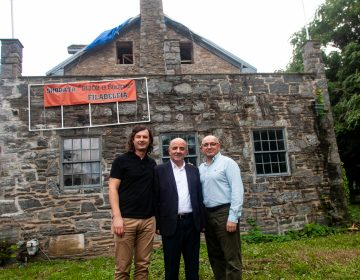 Lead architect Lluka Lakuriqi, left, Tajar Domi, center and Bujar Gjoka of the Albanian American Association are seen outside of the historic Lower Dublin Academy in Northeast Philadelphia. (Brad Larrison for WHYY)