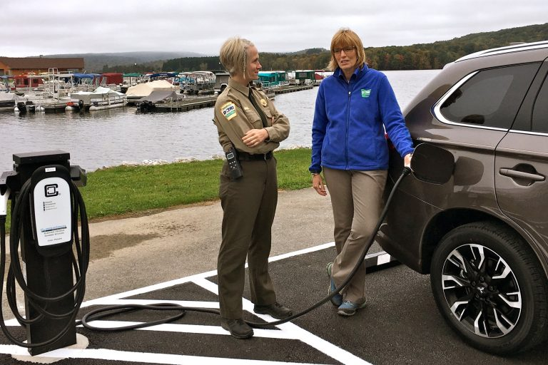 Prince Gallitzin State Park Manager Jessica Lavelua (left) and Department of Conservation and Natural Resources Secretary Cindy Adams Dunn demonstrate an electric vehicle charging station.