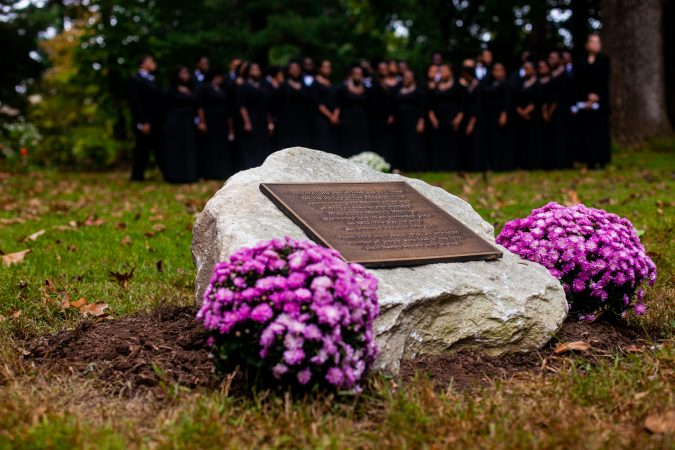 A memorial stone to commemorate the forgotten slaves buried on the grounds of Middletown Friends Meeting at Langhorne, Pa. on Saturday, Oct. 6, 2018. (Brad Larrison for WHYY)