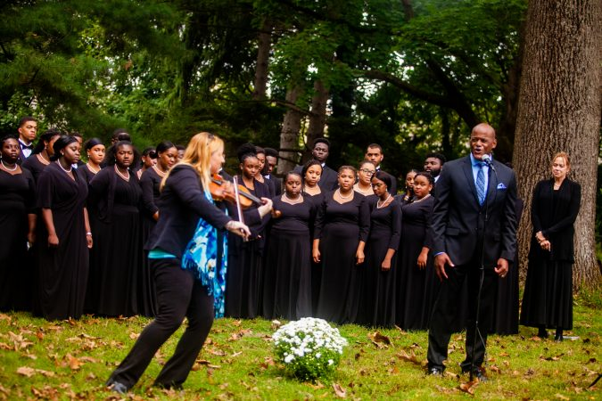 Vocalist Keith Spencer, right, and violinist Claudia Pellegrini, left, perform at a memorial service for the forgotten slaves buried on the grounds of Middletown Friends Meeting at Langhorne, Pa. on Saturday, Oct. 6, 2018. (Brad Larrison for WHYY)