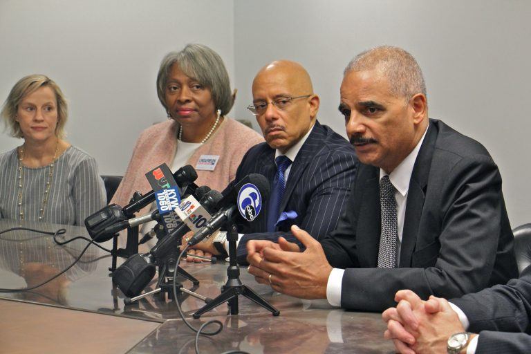 Former U.S. Attorney General Eric Holder (right) throws his weight behind six Democratic Pennsylvania Senate candidates he says will bring an end to partisan gerrymandering in the state. (Emma Lee/WHYY)