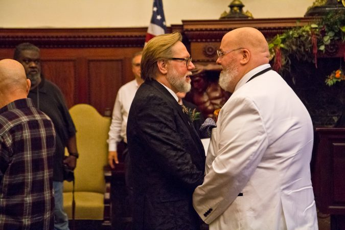 Mark Jerde and Neal Orzeck, a couple of 10 years, renew their vows at the National Coming Out Day event at City Hall Thursday.  (Kimberly Paynter/WHYY)