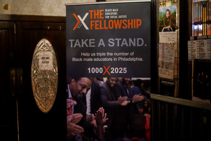 A banner promoting the organization The Fellowship: Black Male Educators for Social Justice seen inside of Union Transfer where events for the organization's second annual convention were held Friday evening. (Brad Larrison for WHYY)