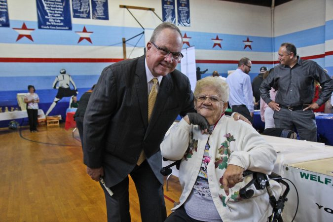 Pennsylvania state Rep.  John Taylor organized a Friday event to get information on Medicare options out to seniors. Rose Marie Webster, a Medicare recipient, attended the expo. (Kimberly Paynter/WHYY)