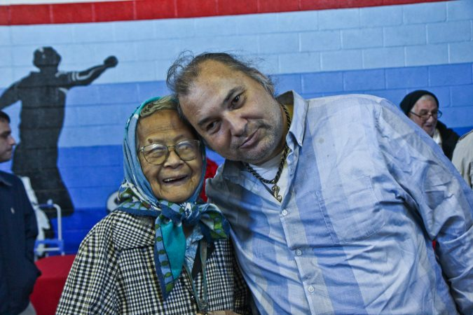 Ruth Young, 92, and her son David Matic attend the senior expo in Port Richmond. (Kimberly Paynter/WHYY)