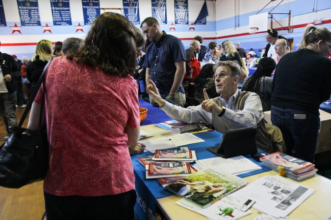 Vendors including health insurance providers, physical trainers, and SEPTA, give out information to seniors at the senior expo in Port Richmond. (Kimberly Paynter/WHYY)