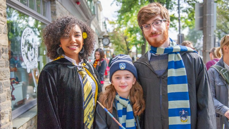 Charlene Delos Santos left, Harley Birkmire, and Joe Birkmire show off their wizard attire on Germantown Avenue. (Jonathan Wilson for WHYY)