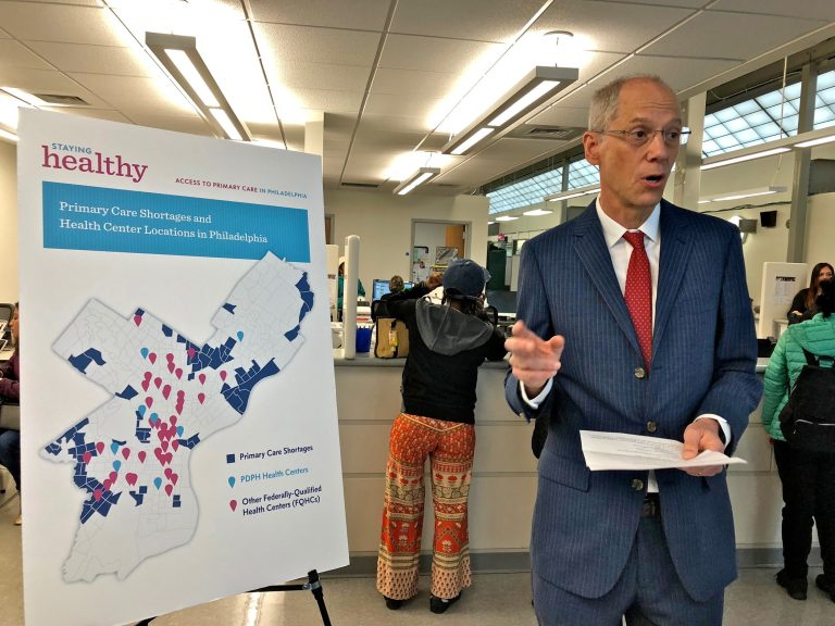 Philadelphia Health Commissioner Tom Farley uses a map to illustrate primary care shortages in neighborhoods in the city's Northeast and Southwest. (Nina Feldman/WHYY)