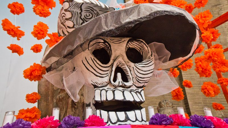 The centerpiece of the Day of the Dead alter at the Penn Museum was created by artist Cesar Viveros. (Kimberly Paynter/WHYY)