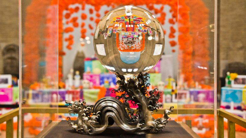 The Day of the Dead altar is reflected in the Penn Museum's crystal sphere. (Kimberly Paynter/WHYY)