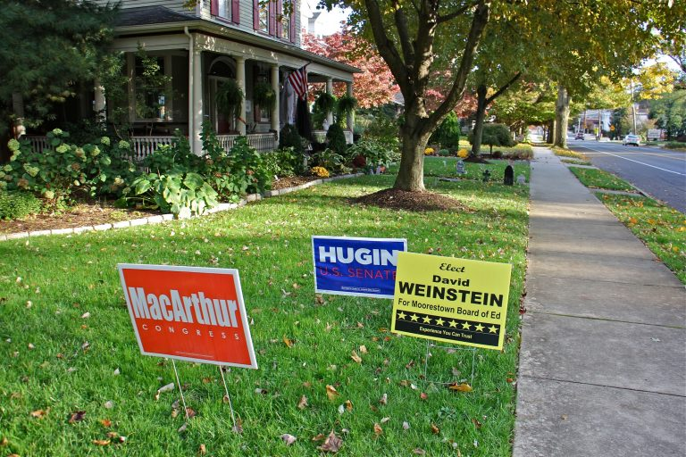 Yard signs on Second Street in Moorestown, New Jersey, support the Republican slate, topped by Bob Hugin for Senate and Tom MacArthur for Congress.