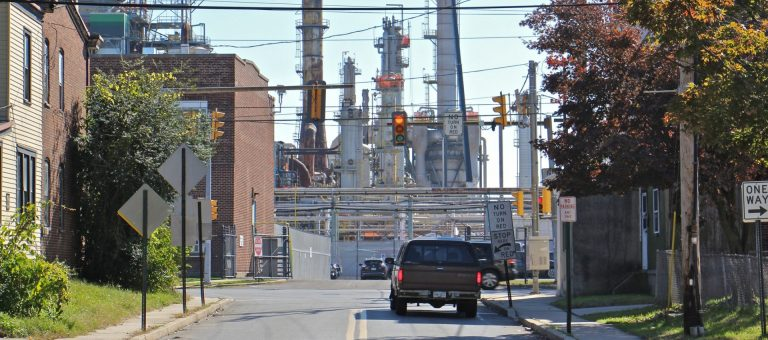 Main Street in Marcus Hook dead ends at the Monroe Energy refinery. (Emma Lee/WHYY)