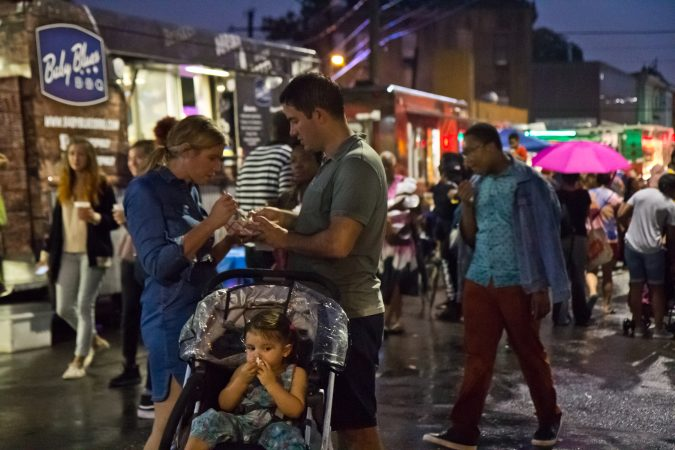 ain doesn't hold off the crowd at the Point Breeze Night Market. (Kimberly Paynter/WHYY)