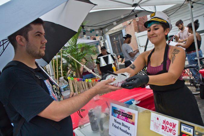 Lydia Heier serves fried ice cream at the Point Breeze Night Market. (Kimberly Paynter/WHYY)