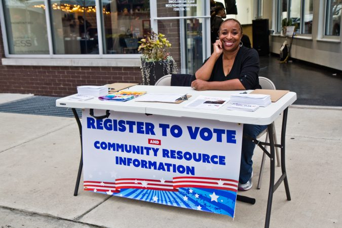Annette Randolph works to register voters at the Point Breeze Night Market. (Kimberly Paynter/WHYY)