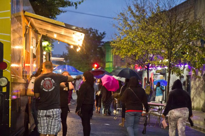 Rain doesn't hold off the crowd at the Point Breeze Night Market. (Kimberly Paynter/WHYY)