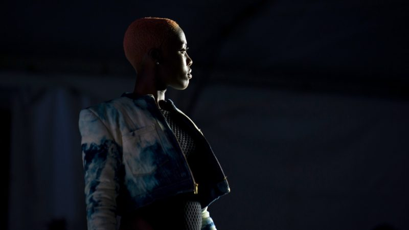 A model poses at the end of the runway during Philadelphia Fashion Week, held at Dilworth Park. (Kriston Jae Bethel for WHYY)