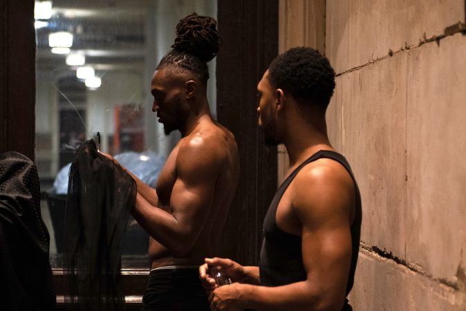 Models prep backstage before the Friday night runway show at Philadelphia Fashion Week, held at Dilworth Park. (Kriston Jae Bethel for WHYY)