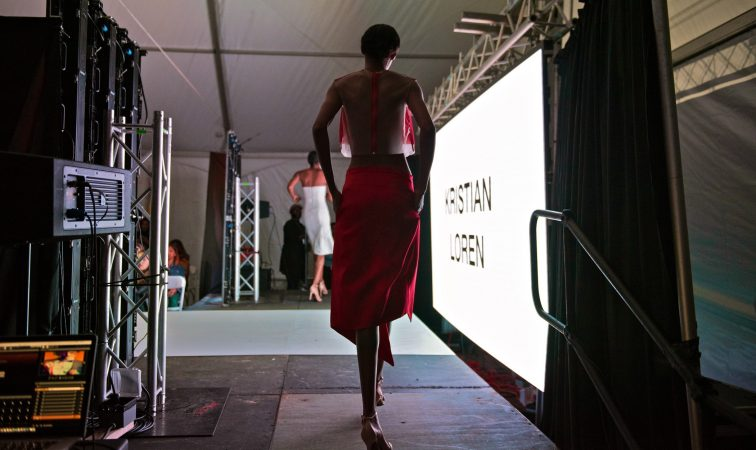 A model steps out to the runway at Philadelphia Fashion Week, held at Dilworth Park. (Kriston Jae Bethel for WHYY)
