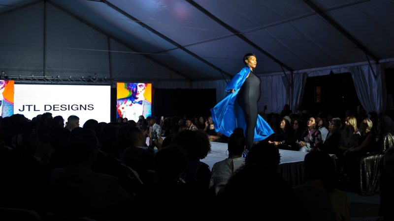 A model is met with cheers as she takes the runway at Philadelphia Fashion Week, held at Dilworth Park. (Kriston Jae Bethel for WHYY)