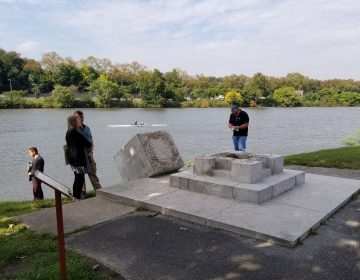 Police are investigating after the statue of a Viking  was toppled from its base along Philadelphia's Boathouse Row. (Tom MacDonald/WHYY)