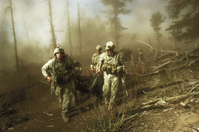 US troops carry the body of Staff Sergeant Larry Rougle, who was killed when Taliban