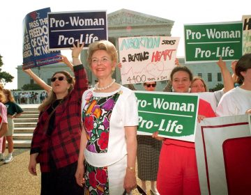 Anti-abortion demonstrators, including Phyllis Schlafly, foreground, rally at the U.S. Supreme Court in Washington, D.C., on June 29, 1992. The high court upheld most provisions of a restrictive Pennsylvania abortion law.