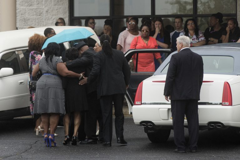 People gather for 18-year-old Bianca Roberson's viewing and funeral at St. Paul's Baptist Church in West Chester, Pa., Friday, July 7, 2017. A man driving down a Pennsylvania highway shot the recent high school graduate in the head, killing her, as the two tried to merge into a single lane, authorities said. (AP Photo/Matt Rourke)